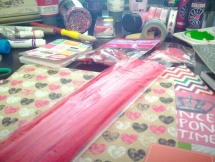 Pipe cleaners and patterned paper.