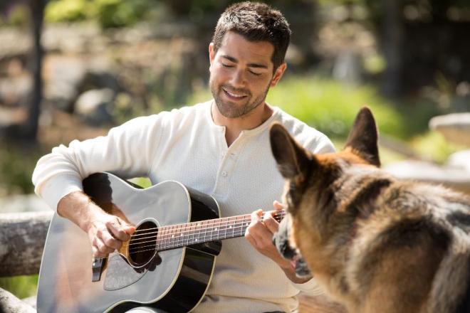 Dog + guitar + hot guy = winning photo.